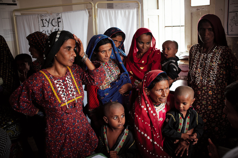 Women wait to be attended by health workers at the Government Health Clinic in the village of Babrio Jat, Thatta, Sindh, Pakistan on July 2, 2011.