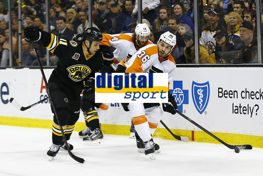 April 5, 2014: Philadelphia Flyers Zac Rinaldo (36) watches by Boston Bruins Gregory Campbell (11). The Boston Bruins defeated the Philadelphia Flyers 5-2 in a regular season NHL Eishockey Herren USA game at TD Garden in Boston, Massachusetts. NHL Eishockey Herren USA APR 05 Flyers at Bruins <br /> Norway only