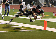 Linn-Mar's Mark Atwater (10) dives into the end zone for a touchdown during the game between Cedar Rapids Kennedy and Linn-Mar at Linn-Mar Stadium in Marion on Friday evening, September 2, 2011. It was 35-7 Linn-Mar at halftime.