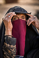 Sinai, Egypt, December 2018.  Lunch at Ein Furtaga with a bedouin woman fortune teller while Hiking with the Tarabin Tribe through the Sinai Desert Coastal Ranges. The Sinai Trail is Egypt's 1st long distance hiking trail, running 230km from the Gulf of Aqaba to the top of the Sinai's highest mountain. It connects old trade, travel and pilgrimage routes through one of the Middle East's most iconic desert wildernesses and is managed by a cooperative of three Bedouin tribes. Photo by Frits Meyst / MeystPhoto.com