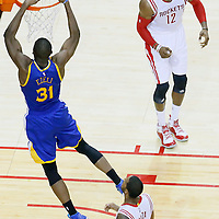 25 May 2015: Golden State Warriors center Festus Ezeli (31) goes for the dunk past Houston Rockets forward Trevor Ariza (1) in front of Houston Rockets center Dwight Howard (12) during the Houston Rockets 128-115 victory over the Golden State Warriors, in game 4 of the Western Conference finals, at the Toyota Center, Houston, Texas, USA.
