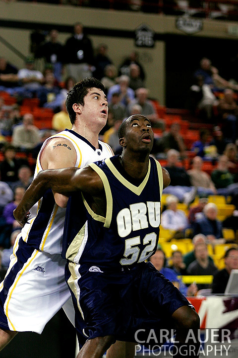 25 November 2005:  Yemi Ogunoye (52), a sophomore forward for Oral Roberts University blocks out Marquette Golden Eagle Ryan Amoroso in the ORU 73-70 loss to Marquette University at the Great Alaska Shootout in Anchorage, Alaska.