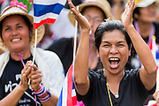 A Thai anti-government protestor cheers an opposition speaker during a rally at the Ministry of Finance in Bangkok. Protestors opposed to the government of Thai Prime Minister Yingluck Shinawatra spread out through Bangkok this week. Protestors have taken over the Ministry of Finance, Ministry of Sports and Tourism, Ministry of the Interior and other smaller ministries. The protestors are demanding the Prime Minister resign, the Prime Minister said she will not step down. This is the worst political turmoil in Thailand since 2010 when 90 civilians were killed in an army crackdown against Red Shirt protestors. The Pheu Thai party, supported by the Red Shirts, won the 2011 election and now govern. The protestors demanding the Prime Minister step down are related to the Yellow Shirt protestors that closed airports in Thailand in 2008.