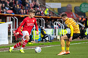 Lloyd Isgrove of Swindon Town takes on Harry Pickering of Crewe Alexandra during the EFL Sky Bet League 2 match between Swindon Town and Crewe Alexandra at the County Ground, Swindon, England on 11 January 2020.