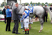 Trainer David Menuisier celebrates with Andrea Atzeni the roder of  THUNDERING BLUE after winning The Equinity Technology Handicap Stakes over 1m 2f (£30,000)   at the York Dante Meeting at York Racecourse, York, United Kingdom on 18 May 2018. Picture by Mick Atkins.