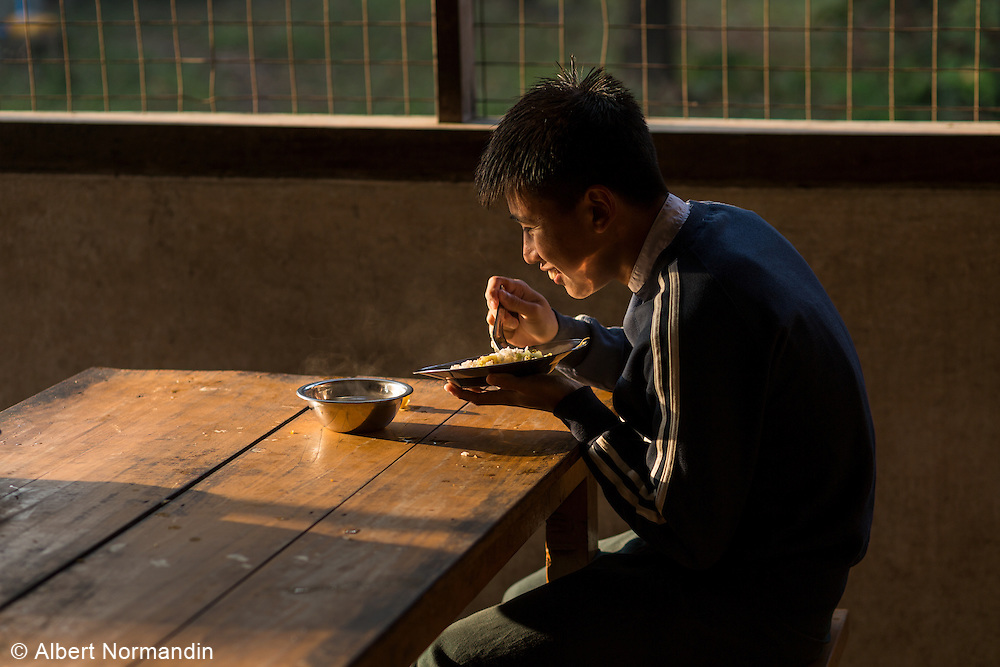 Young blind man having breakfast, Myitkyina