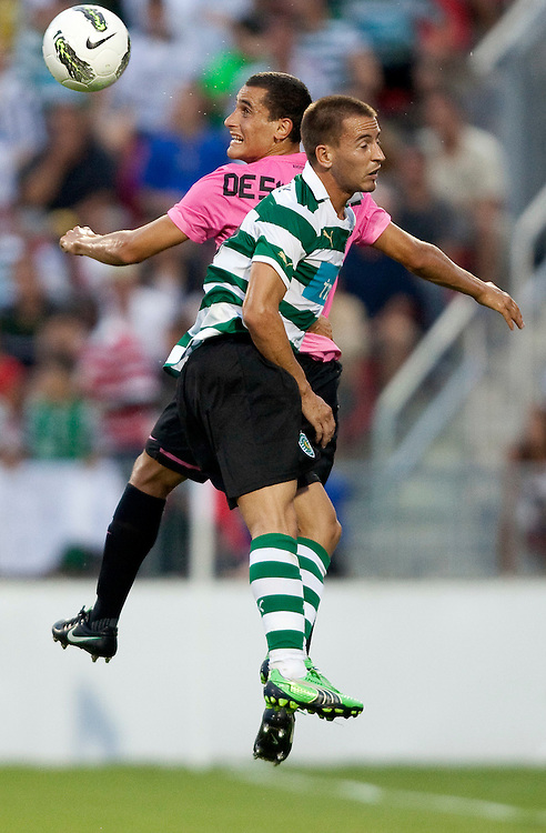 -20110723- Toronto, Ontario,Canada--<br /> Elio De Silvestro of Juventus F.C. and Sporting Clube de Portugal's Joao Pereira jump for the ball during the second half of a friendly, part of the Herbalife World Football Challenge, at BMO field in Toronto, Ontario, July 23, 2011.  Sporting Clube de Portugal defeated Juventus 2-1.<br /> AFP PHOTO/Geoff Robins