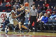 Texas A&M's Alex Caruso (21) is defended by Ole Miss' LaDarius White (10) in Oxford, Miss. on Wednesday, February 27, 2013. (AP Photo/Oxford Eagle, Bruce Newman)