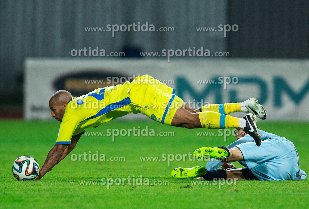 Joshua Kevin Stanley Parker #23 of Domzale faulted by Marco Modolo of Gorica during football match between NK Domzale and ND Gorica in 10th Round of Prva liga Telekom Slovenije 2014/15, on September 24, 2014 in Sports park Domzale, Slovenia. Photo by Vid Ponikvar / Sportida.com