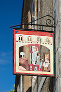 Traditional sign for shop in Parce-Sur-Sarthe, France