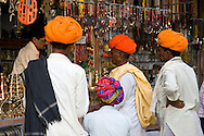 Four men in colourful turbans outside a shop in Pushkar, Rajasthan, India