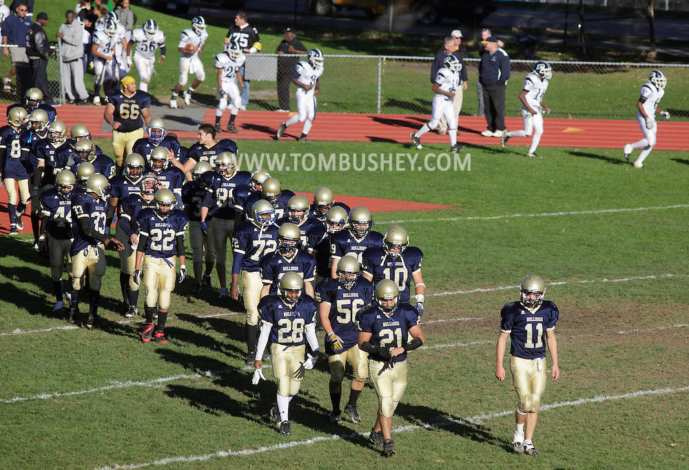 Beacon, New York - The Beacon, at left, and Poughkeepsie teams return to the field after halftime at a high school football game on Saturday, Oct. 10, 2009.