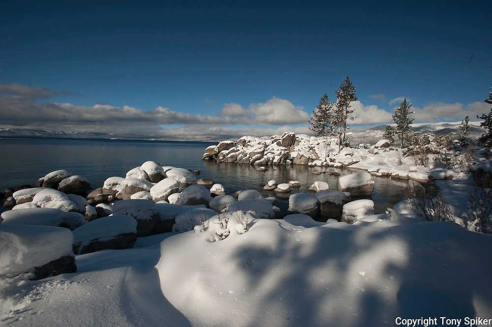 """Winter at Sand Harbor 1"" - A landscape photograph of snow covered boulders taken at Sand Harbor, Lake Tahoe after a winter storm"