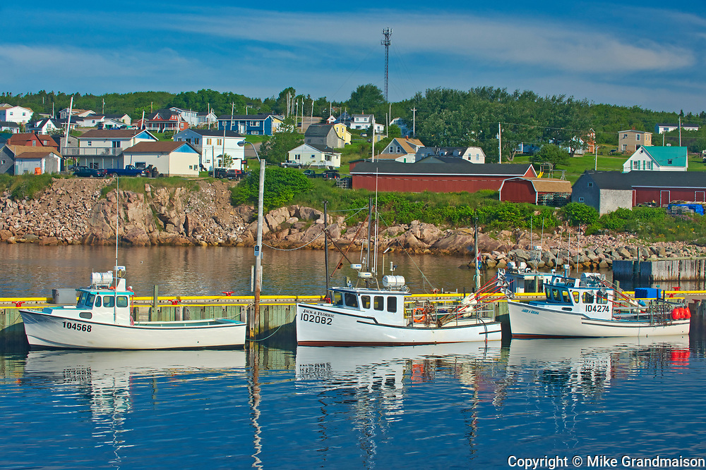 Fishing boats in coastal village. Cabot Trail. Cape Breton Island. <br />