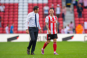 Chris Maguire (#7) of Sunderland AFC is congratulated by Sunderland AFC manager, Jack Ross at the final whistle after he scores a hat-trick during the EFL Sky Bet League 1 match between Sunderland and AFC Wimbledon at the Stadium Of Light, Sunderland, England on 24 August 2019.