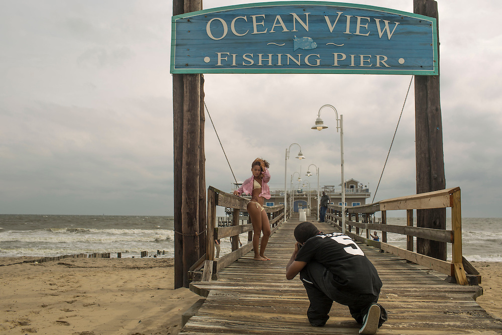 NORFOLK, VA - JULY 4: Kayla Cason, of Va. Beach, poses for photographer Dexter Cohen, of Chesapeake, Va., during a fashion shoot on Friday, July 4th, 2014 in Norfolk, Va. (Photo by Jay Westcott/For The Virginian-Pilot)