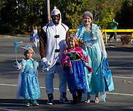 Middletown, New York  - A family in costume arrives at the Halloween Fall Festival at the Middletown YMCA's Center for Youth Programs on Oct. 25, 2014.