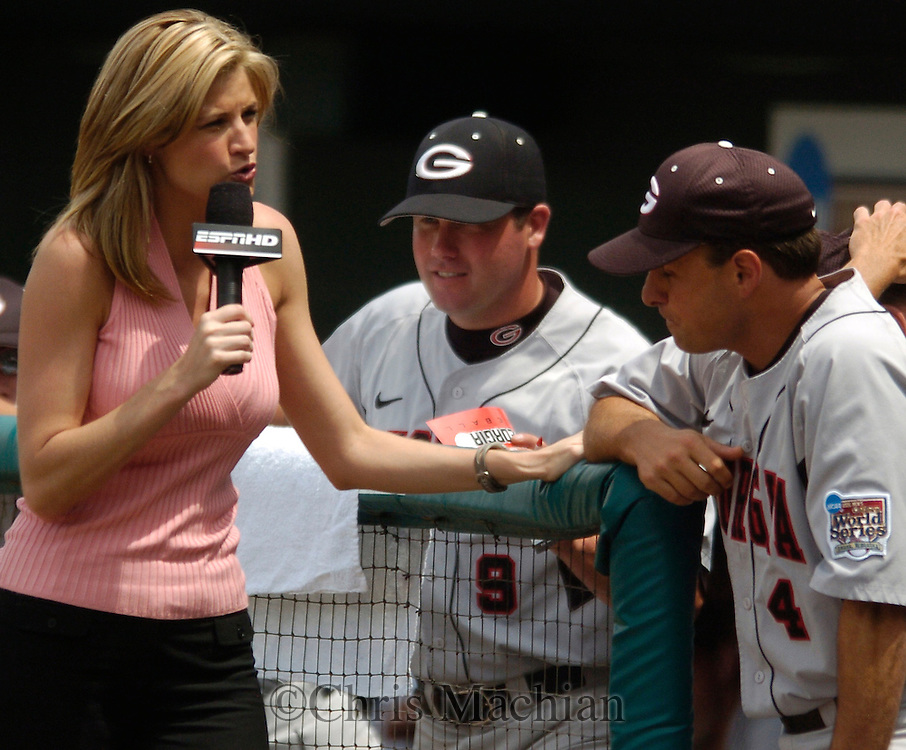 06/17/2006  Georgia head coach  David Perno gets interviewed by ESPN's Erin Andrews in the fifth inning during, game 3 of the College World Series in Omaha Nebraska Saturday afternoon.. Photo by Chris Machian