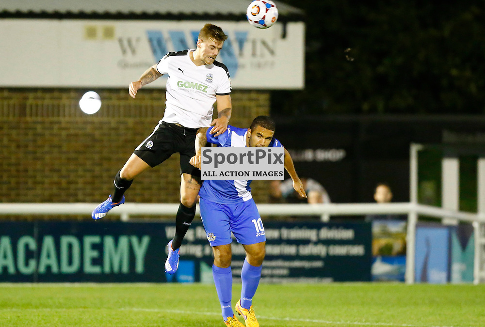 Dover's striker Ricky Miller (9) towers over Eastleigh's midfielder Jai Reason (10). Dover Athletic v Eastleigh. Vanarama National League. 10  November 2015. (c) Matt Bristow | SportPix.org.uk
