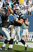 CHARLOTTE, NC - NOVEMBER 7:  Tight end Kris Mangum #86 of the Carolina Panthers slaps a high five on a teammate after scoring a touchdown on a one yard pass from quarterback Jake Delhomme against the Oakland Raiders at Bank of America Stadium on November 7, 2004 in Charlotte, North Carolina. The Raiders defeated the Panthers 27-24. ©Paul Anthony Spinelli  *** Local Caption *** Kris Mangum