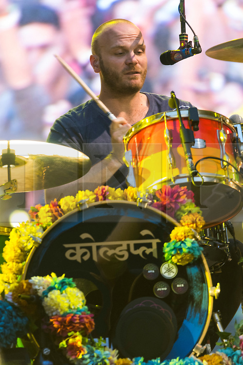 © Licensed to London News Pictures. 15/06/2016.  Coldplay member WILL CHAMPION plays at Wembley Stadium during their Handful of Dreams World tour.<br /> <br /> Please note this supplied photo is for editorial usage only and cannot be used for merchandise.  This supplied photo must be deleted and withdraw from usage on 14th September 2016 as agreed by Coldplay management.  London, UK. Photo credit: Ray Tang/LNP