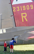 Montgomery, New York - Two children examine the rear a B-17 Flying Fortress bomber at Orange County Airport on Oct. 2, 2010. Three World War II planes from the Collings Foundation wereon display and available for tours and flights at Orange County Airport on Oct. 2, 2010.