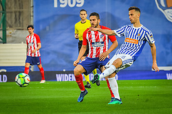 April 19, 2018 - San Sebastian, Spain - Sergio Canales of Real Sociedad duels for the ball with Koke of Atletico Madrid during the Spanish league football match between Real Sociedad and Atletico Madrid at the Anoeta Stadium on 19 April 2018 in San Sebastian, Spain  (Credit Image: © Jose Ignacio Unanue/NurPhoto via ZUMA Press)