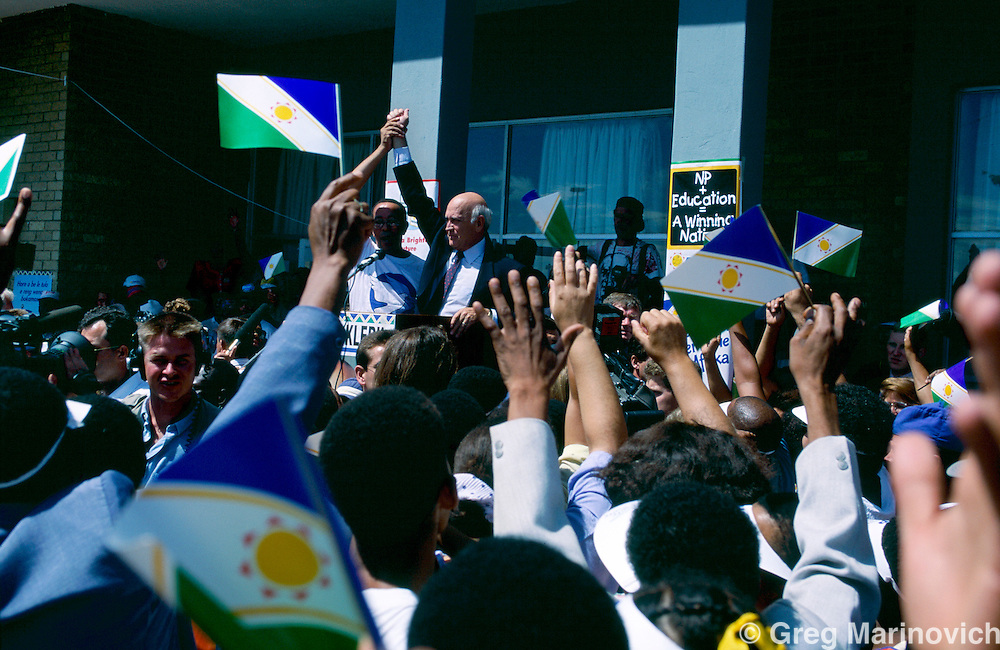President FW de Klerk is greeted by crowds at a rally in the run up to the first non racial election in South Africa, 1994.