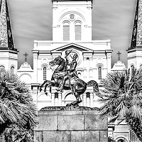 New Orleans St. Louis Cathedral panorama photo in black and white. The Cathedral-Basilica of St. Louis King of France and General Andrew Jackson statue are located in Jackson Square and was completed in 1794. Panorama ratio is 1:3.