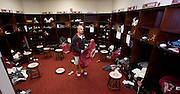 Equipment managers work in the Mal Moore Athletic Facility to get the University of Alabama football team ready for the trip to Baton Rouge to face LSU.  Equipment manager Jeff Springer, in his second years as Bama's equipment manager, helps distribute bags in the locker room for players to put their shoes, helmets and pads into for shipping.  Photo by Gary Cosby Jr.