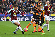 Hull City midfielder Shaun Maloney (15) and Burnley FC defender Ben Mee (6)  during the Premier League match between Hull City and Burnley at the KCOM Stadium, Kingston upon Hull, England on 25 February 2017. Photo by Ian Lyall.