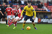 Scunthorpe United defender Jack King moves the ball out of the danger area during the Sky Bet League 1 match between Swindon Town and Scunthorpe United at the County Ground, Swindon, England on 14 November 2015. Photo by Mark Davies.