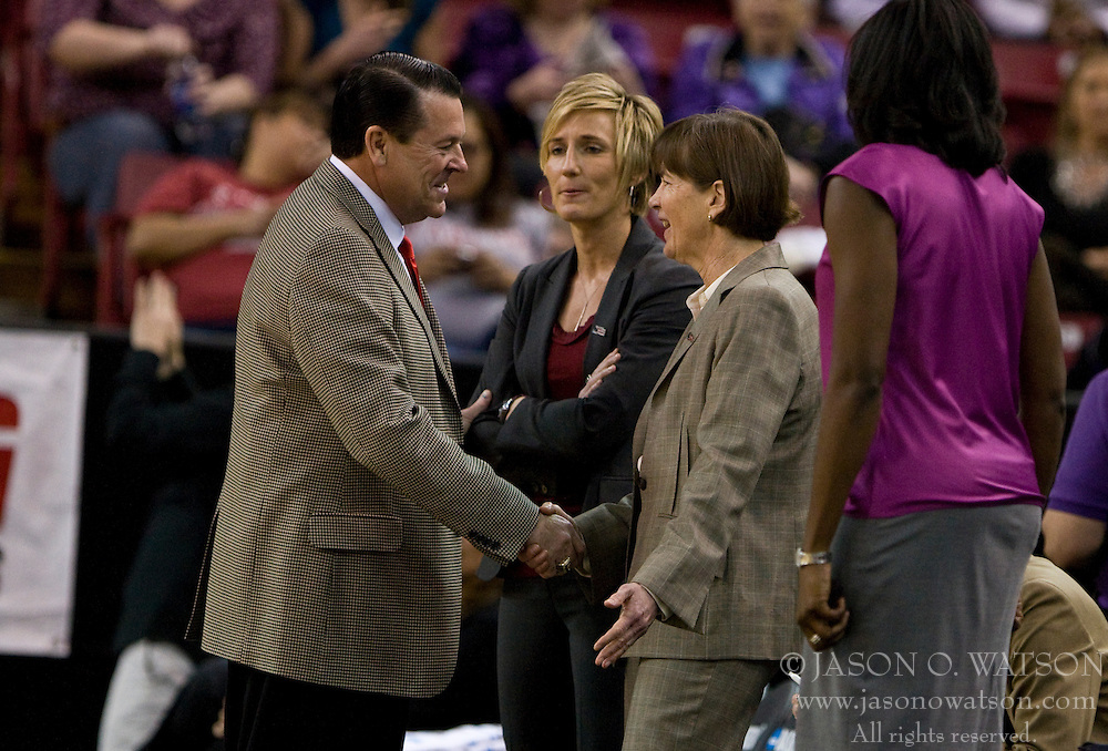 March 27, 2010; Sacramento, CA, USA; Georgia Bulldogs head coach Andy Landers shakes hands with Stanford Cardinal head coach Tara VanDerveer before the game in the semifinals of the Sacramental regional in the 2010 NCAA womens basketball tournament at ARCO Arena.  Stanford defeated Georgia 73-36.