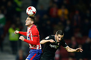 Atletico Madrid's French defender Lucas Hernandez heads the ball during the Spanish Cup, Copa del Rey quarter final, 1st leg football match between Atletico Madrid and Sevilla FC on January 17, 2018 at Wanda Metropolitano stadium in Madrid, Spain - Photo Benjamin Cremel / ProSportsImages / DPPI