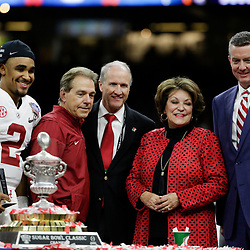 Jan 1, 2018; New Orleans, LA, USA; Alabama Crimson Tide quarterback Jalen Hurts (2) poses for a photo with Alabama Crimson Tide head coach Nick Saban (second from left) and Terry Saban (second from right) after the game against the Clemson Tigers in the 2018 Sugar Bowl college football playoff semifinal game at Mercedes-Benz Superdome. Mandatory Credit: Derick E. Hingle-USA TODAY Sports