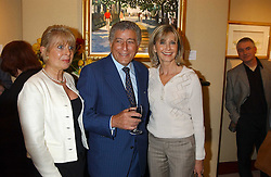 Left to right, GILL CATTO, TONY BENNETT and OLIVIA NEWTON-JOHN at a private view of paintings by singer Tony Bennett held at the catto Gallery, 100 Heath Street, London NW3 on 5th April 2005.<br />