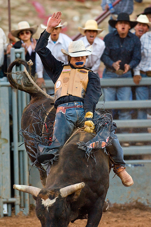 061611       Brian Leddy.Ty Toadlena hangs tight to his bull Thursday evening during the Red Rock Rodeo. Toadlena scored a 78 for his ride.