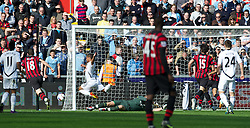 SWANSEA, WALES - Sunday, March 11, 2012: Manchester City's goalkeeper Joe Hart brings down Swansea City's Wayne Routledge for a penalty during the Premiership match at the Liberty Stadium. (Pic by David Rawcliffe/Propaganda)
