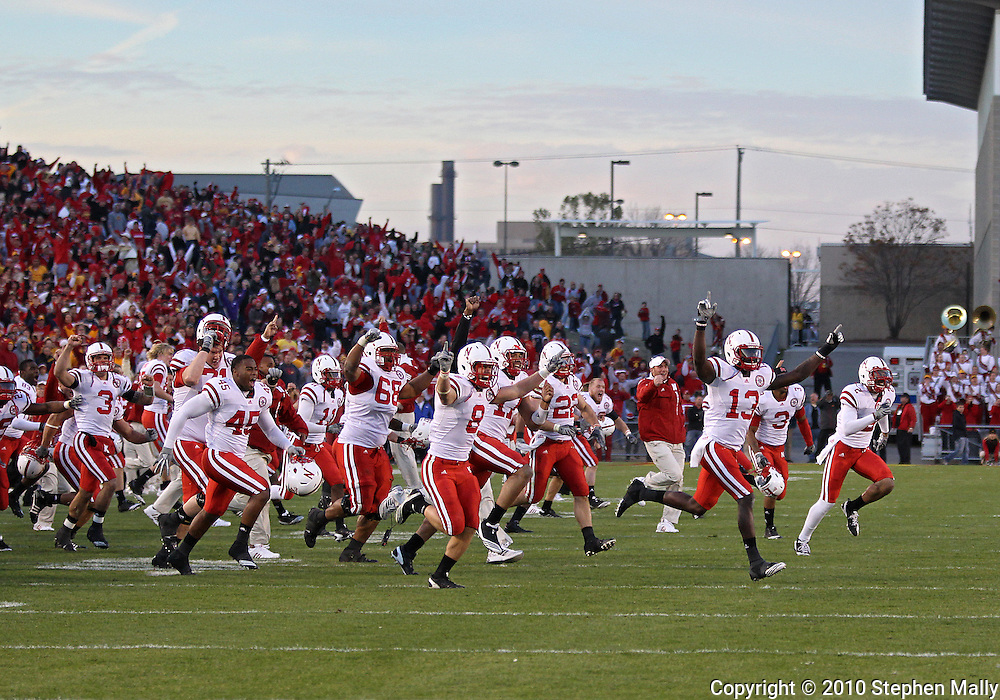 November 06 2010: The Nebraska Cornhuskers storm the field after the fail two point conversion by Iowa State during overtime of the NCAA football game between the Nebraska Cornhuskers and the Iowa State Cyclones at Jack Trice Stadium in Ames, Iowa on Saturday November 6, 2010. Nebraska defeated Iowa State 31-30.