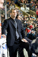 KELOWNA, CANADA, FEBRUARY 8: Darren Rumble assistant coach of the Seattle Thunderbirds stands on the bench as the Seattle Thunderbirds visit the Kelowna Rockets on February 8, 2012 at Prospera Place in Kelowna, British Columbia, Canada (Photo by Marissa Baecker/www.shootthebreeze.ca) *** Local Caption ***