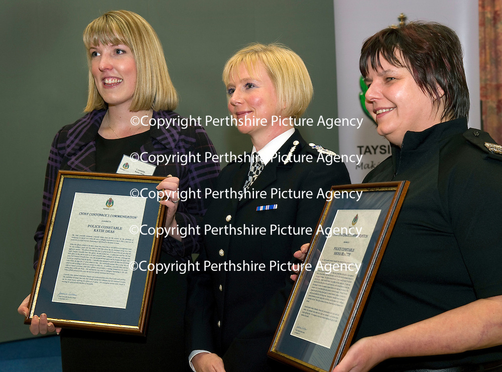 Tayside Police Chief Constable's Commendation to Constables Shona Beattie (right) and Katie Deas for the actions on Tuesday March 29th 2011 when they attended a call to a report that a man was threatening to kill himself, on arrival the agressive man was CS sprayed but still managed to stab PC Beattie in the arm, Constable Deas managed to CS spray the man a second time and he dropped the knife before picking up an axe and weilding it at her.<br /> Picture by Graeme Hart.<br /> Copyright Perthshire Picture Agency<br /> Tel: 01738 623350  Mobile: 07990 594431