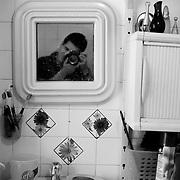 APUNTES SOBRE MI VIDA: LA PASTORA I - 2009/10<br /> Photography by Aaron Sosa<br /> Autorretrato en el baño. Casa de la Familia Sosa. Castillitos.<br /> La Pastora, Caracas - Venezuela 2009<br /> (Copyright © Aaron Sosa)