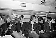 The Rolling Stones Charlie is my Darling - Ireland 1965 -..The Rolling Stones in the airport bus on route to the customs hall at Dublin Airport before thier concert at the Adelphi Theatre, Middle Abbey Street, Dublin.  L-R: Brian Jones (guitar), Charlie Watts (drums), Mick Jagger (vocals), Keith Richards (guitar) and  Bill Wyman (bass). This was the band's second Irish tour of 1965....The Rolling Stones Charlie is my Darling - Ireland 1965.Out November 2nd from ABKCO.Super Deluxe Box Set/Blu-ray and DVD Details Revealed. ..03/09/1965..09/03/1965..03 September 1965...ABKCO Films is proud to join in the celebration of the Rolling Stones 50th Anniversary by announcing exclusive details of the release of the legendary, but never before officially released film, The Rolling Stones Charlie is my Darling - Ireland 1965.  The film marked the cinematic debut of the band, and will be released in Super Deluxe Box Set, Blu-ray and DVD configurations on November 2nd (5th in UK & 6th in North America).. .The Rolling Stones Charlie is my Darling - Ireland 1965 was shot on a quick weekend tour of Ireland just weeks after ?(I Can't Get No) Satisfaction? hit # 1 on the charts and became the international anthem for an entire generation.  Charlie is my Darling is an intimate, behind-the-scenes diary of life on the road with the young Rolling Stones featuring the first professionally filmed concert performances of the band's long and storied touring career, documenting the early frenzy of their fans and the riots their live performances incited.. .Charlie is my Darling showcases dramatic concert footage - including electrifying performances of ?The Last Time,? ?Time Is On My Side? and the first ever concert performance of the Stones counterculture classic, ?(I Can't Get No) Satisfaction.?  Candid, off-the-cuff interviews are juxtaposed with revealing, comical scenes of the band goofing around with each other. It's also an insider's glimpse into the band's developing musical style by bl