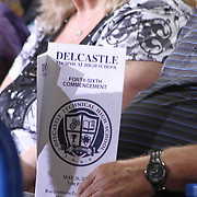 Family and friends in the stands review Delcastle Technical high school program in the stands during Delcastle high school commencement exercises Tuesday, May 26, 2015, at The Bob Carpenter Sports Convocation Center in Newark, Delaware