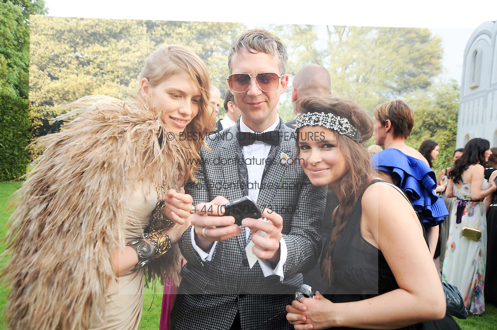 Left to right, ELENA PERMINOVA, JEFFERSON HACK and MIROSLAVA DUMA  at the Raisa Gorbachev Foundation Party held at Stud House, Hampton Court Palace on 5th June 2010.  The night is in aid of the Raisa Gorbachev Foundation, an international fund fighting child cancer.