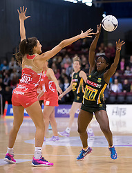 South Africa's Bongiwe Msomi, right, looks to pass the ball around England's Beth Cobden, in the Netball Quad Series netball match, ILT Stadium Southland, Invercargill, New Zealand, Sept. 3 2017.  Credit:SNPA / Adam Binns ** NO ARCHIVING**
