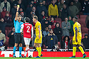 Sandro Scharer (Referee) awarded a yellow card to both Hector Bellerin (Capt) (Arsenal) & Mërgim Vojvoda (Liège) during the Europa League match between Arsenal and Standard Liege at the Emirates Stadium, London, England on 3 October 2019.