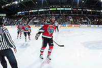KELOWNA, CANADA - OCTOBER 31: Devante Stephens #21 of Kelowna Rockets skates to the bench to celebrate a goal against the Lethbridge Hurricanes on October 31, 2015 at Prospera Place in Kelowna, British Columbia, Canada.  (Photo by Marissa Baecker/Shoot the Breeze)  *** Local Caption *** Devante Stephens;