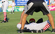 July 5, 2017 - Trenton, New Jersey, U.S - Trenton Thunder Strength Coach ANTHONY VELAZQUEZ (blue/gray shorts) helps Thunder player JORGEO MATEO stretch before the game tonight vs. the Fightin Phils at ARM & HAMMER Park. The team wore patriotic jerseys for the games on July 4th and today, July 5th. (Credit Image: © Staton Rabin via ZUMA Wire)