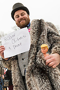 A demonstrator poses as a Russian oligarch during the Women's March on Washington in protest to President Donald Trump January 21, 2017 in Washington, DC. More than 500,000 people crammed the National Mall in a peaceful and festival rally in a rebuke of the new president.